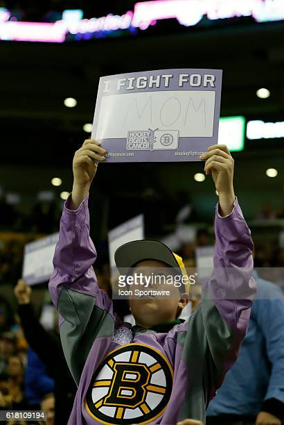 A young fan with a sign for his Mom on Stand Up To Cancer Night The Minnesota Wild defeated the Boston Bruins 50 in a regular season NHL game at TD...