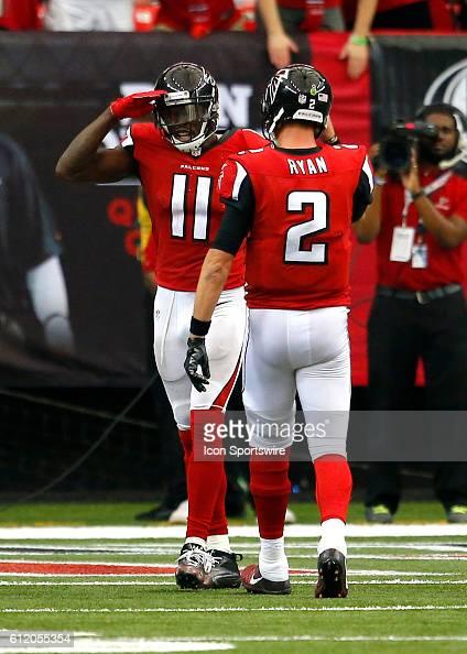 Atlanta Falcons wide receiver Julio Jones celebrates a touchdown with quarterback Matt Ryan in the Atlanta Falcons 4833 victory over the Carolina...