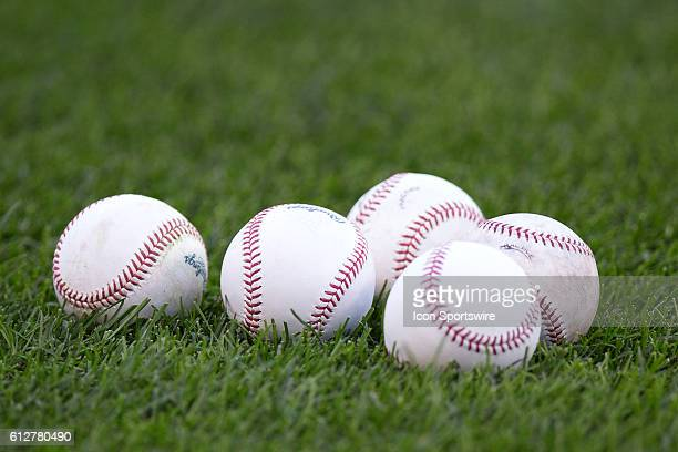 Baseballs sit on the grass as the Cleveland Indians workout in preparation for the American League Divisional Series against the Boston Red Sox at...
