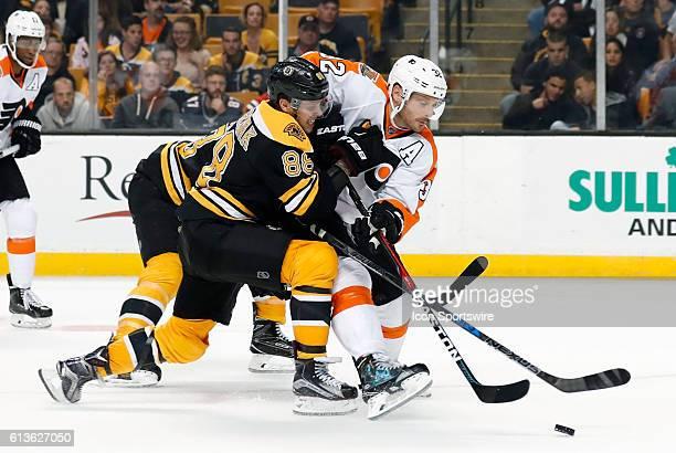 Boston Bruins right wing David Pastrnak [10786] puts the pressure on Philadelphia Flyers defenseman Mark Streit The Boston Bruins defeated the...