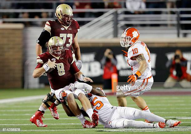 Boston College quarterback Patrick Towles tackled by Clemson Tigers cornerback Cordrea Tankersley as Clemson Tigers linebacker Ben Boulware moves in...