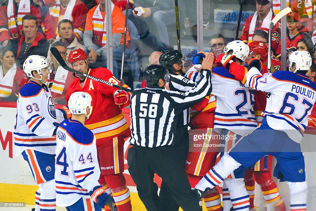 Calgary Flames Left Wing Matthew Tkachuk (19) and Edmonton Oilers Defenceman Darnell Nurse (25) gets in a fight during an NHL Hockey game between the Calgary Flames and the Edmonton Oilers at the Scotiabank Saddledome in Calgary, AB.