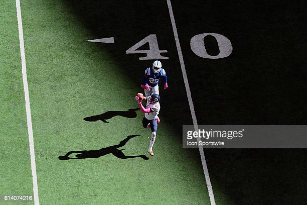 Chicago Bears Wide Receiver Cameron Meredith beats Indianapolis Colts Cornerback Patrick Robinson to catch a football in action during a game between...