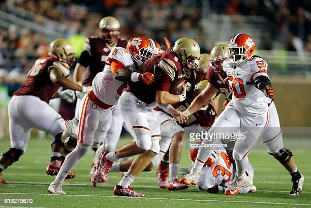 Clemson Tigers linebacker Dorian O'Daniel and Clemson Tigers defensive lineman Jabril Robinson combine to sack Boston College quarterback Patrick...