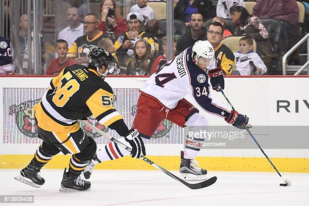 Columbus Blue Jackets right wing Josh Anderson skates with the puck in front of Pittsburgh Penguins defenseman Kris Letang during the second period...
