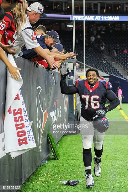 Houston Texans Offensive Tackle Duane Brown high fives avid Texans fans following the NFL game between the Indianapolis Colts and Houston Texans at...