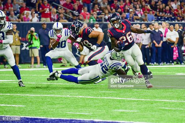 Houston Texans Running Back Lamar Miller slips a tackle and scores a late second half touchdown during the NFL game between the Indianapolis Colts...