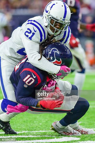 Indianapolis Colts Cornerback Vontae Davis wraps up Houston Texans Wide Receiver DeAndre Hopkins during the NFL game between the Indianapolis Colts...