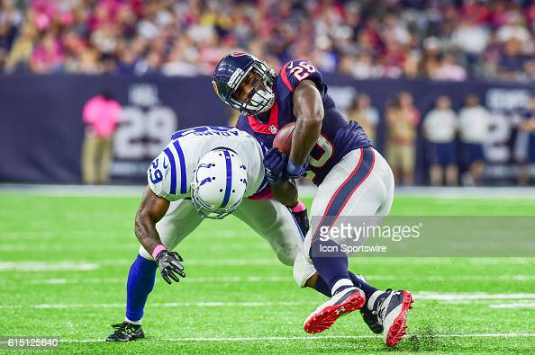Indianapolis Colts Safety Mike Adams puts a big hit on Houston Texans Running Back Lamar Miller during the NFL game between the Indianapolis Colts...