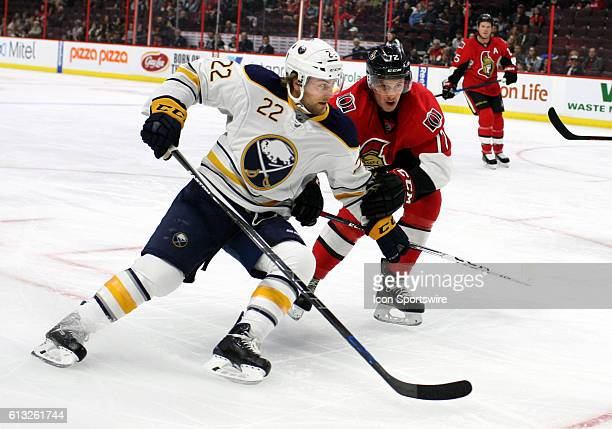 John Larsson moves around Thomas Chabot during a preseason game between the Sabres and Seantors at Canadian Tire Centre in Ottawa On