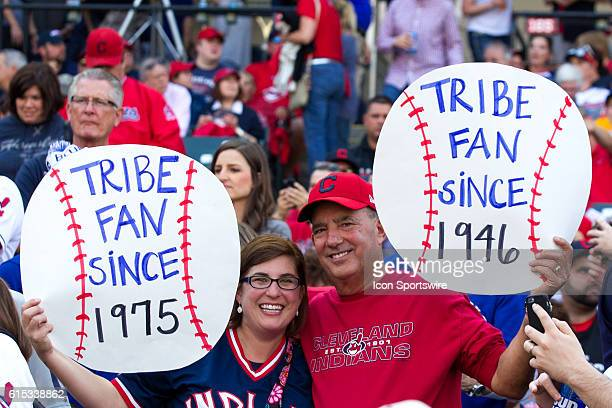 Long time Cleveland Indians fans hold up signs prior to the American League Championship Series Game 2 between the Toronto Blue Jays and Cleveland...