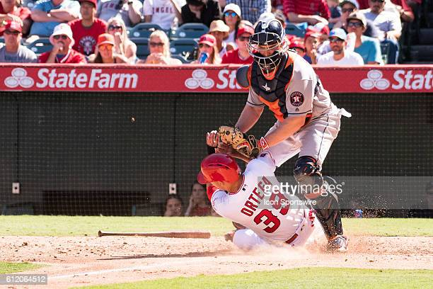 Los Angeles Angels of Anaheim Outfield Rafael Ortega slides into home Houston Astros Catcher Max Stassi for an out during the game against the...