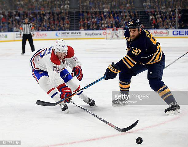Montreal Canadiens left wing Artturi Lehkonen is stick checked by Buffalo Sabres center Ryan O'Reilly during an NHL game between the Montreal...