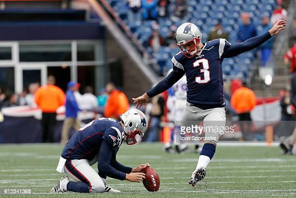 New England Patriots kicker Stephen Gostkowski warms up as New England Patriots punter Ryan Allen holds The Buffalo Bills defeated the New England...