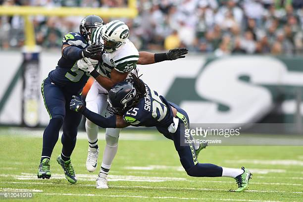 New York Jets Running Back Matt Forte is tackled in the secondary by Seattle Seahawks Cornerback Richard Sherman during the NY Jets vs Seattle...