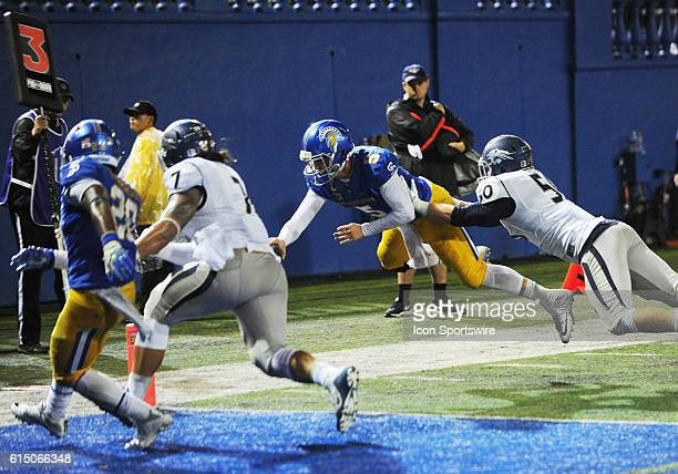 San Jose State Spartans quarterback Kenny Potter flies through the air trying tocross the end zone plane on a quarterback keeper during a NCAA...
