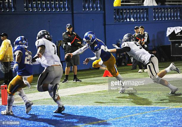 San Jose State Spartans quarterback Kenny Potter outstretches his arm to try to cross the end zone plane on a quarterback keeper during a NCAA...