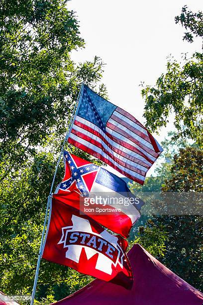 The controversial Mississippi state flag featuring the 'Stars and Bars' between the United States flag and a Mississippi State flag before the Auburn...