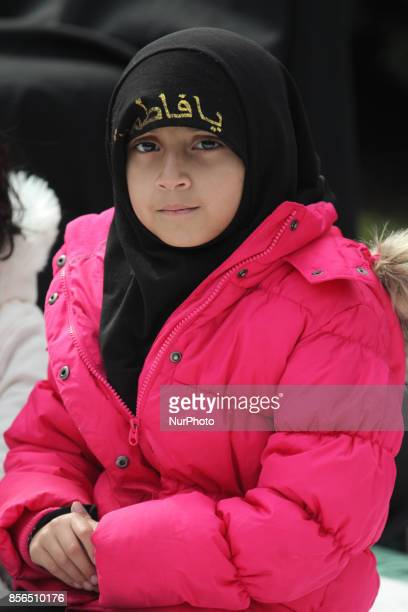 October 2016 Toronto Ontario Canada A Pakistani Shiite Muslims girl listens to prayers being recited from the Quran during the holy month of Muharram...