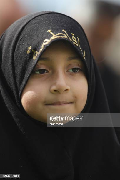 October 2016 Toronto Ontario Canada Pakistani Shiite Muslim girl wearing a hijab at an Ashura procession during the holy month of Muharram to...