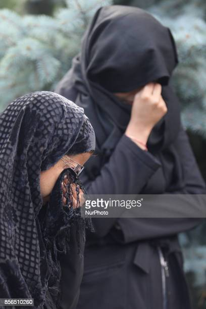 October 2016 Toronto Ontario Canada Pakistani Shiite Muslim women cry as they listen to an imam recite Quranic poetry describing the death of Imam...
