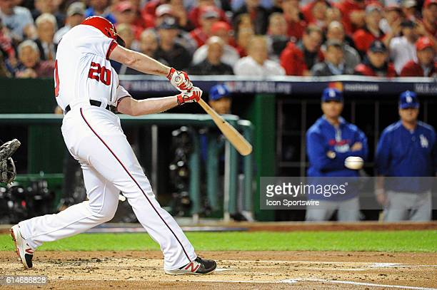 Washington Nationals second baseman Daniel Murphy hits a single in the second inning against the Los Angeles Dodgers at Nationals Park in Washington...
