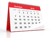 2018 October page of a red plastic framed desktop calendar on white background. 3D Rendering.