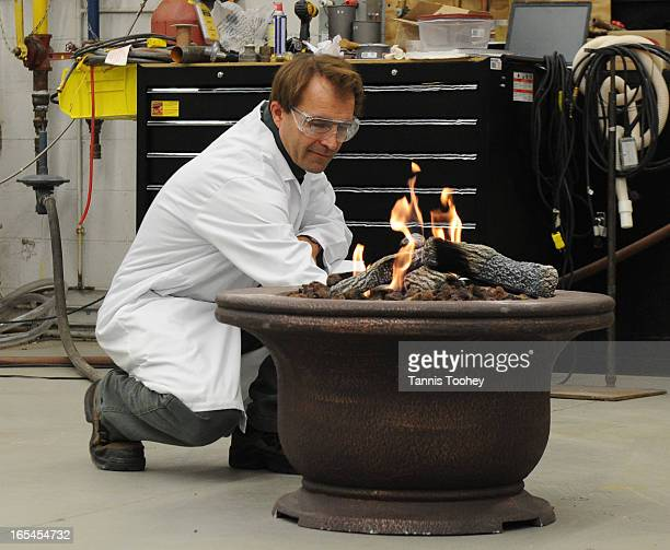 October 21 2010A CSA employee checks on an outdoor firepit after it passed a wind test in the onsite testing facilities of CSA Group a leading...
