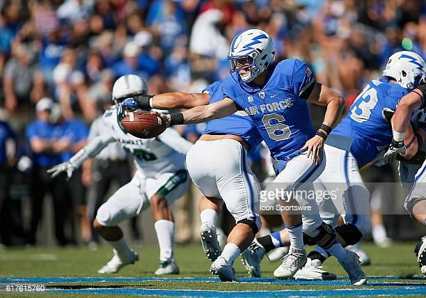 Air Force Falcons Quarterback Nate Romine hands the ball off during a Mountain West Conference matchup between the University of Hawaii Rainbow...