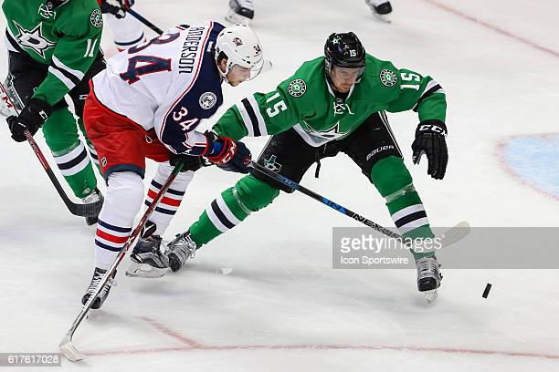 Columbus Blue Jackets Right Wing Josh Anderson and Dallas Stars Defenceman Patrik Nemeth fight for a loose puck during the NHL game between the...