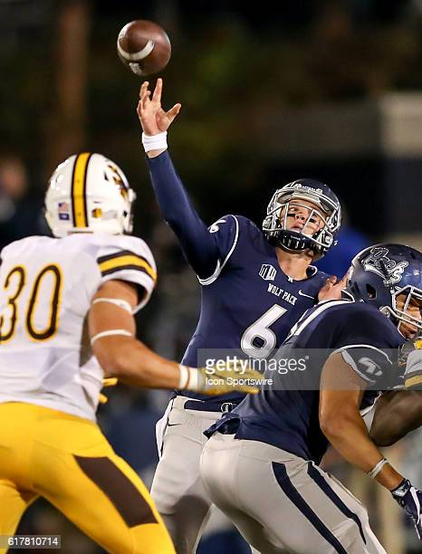 Nevada Wolf Pack QB Ty Gangi attempts a pass during the game between the Wyoming Cowboys and the Nevada Wolf Pack played at Mackay Stadium in Reno...