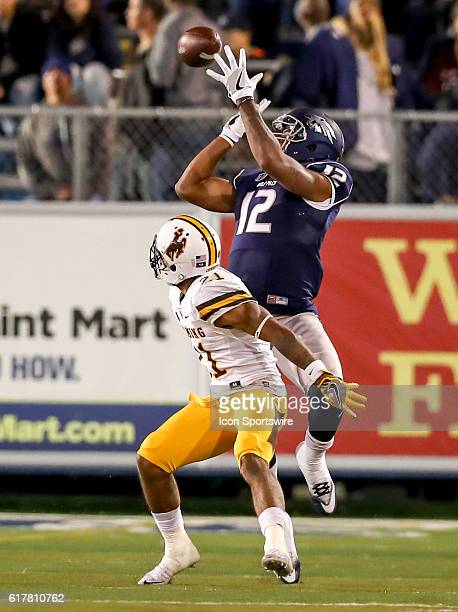Nevada Wolf Pack WR Hasaan Henderson goes up for the ball against Wyoming CB Antonio Hull during the game between the Wyoming Cowboys and the Nevada...