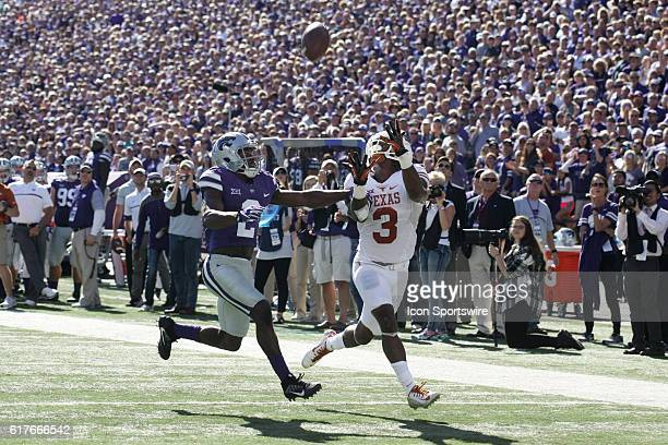 Texas Longhorns wide receiver Armanti Foreman is defended by Kansas State Wildcats defensive back DJ Reed on a pass during the Texas Longhorns game...