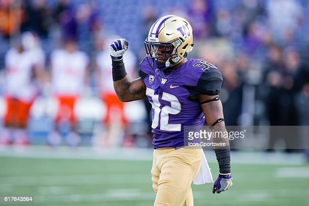 Washington defensive back Budda Baker celebrates a defensive stop against the Oregon State Beavers at Husky Stadium in Seattle WA Washington defeated...