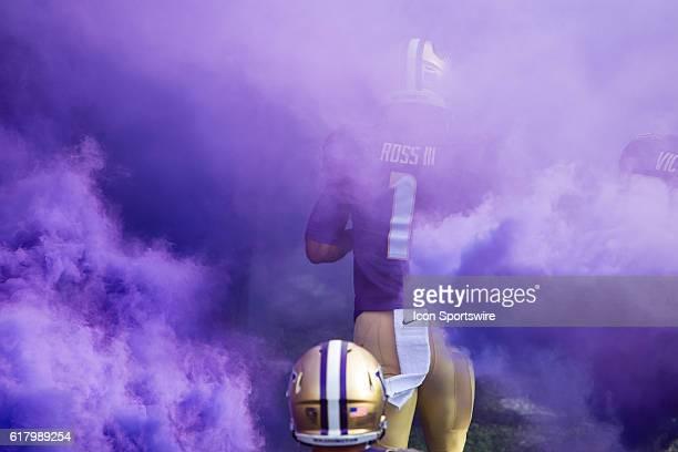 Washington Huskies wide receiver John Ross runs through purple smoke before facing the Oregon State Beavers at Husky Stadium in Seattle WA