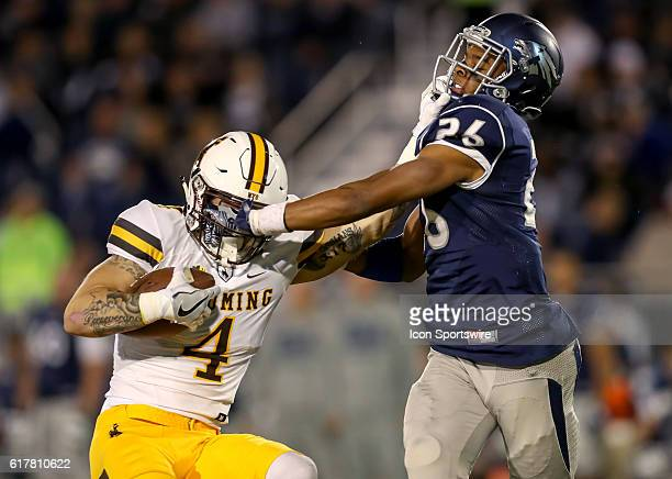 Wyoming Cowboys WR Tanner Gentry fights off Nevada CB Kendall Johnson during the game between the Wyoming Cowboys and the Nevada Wolf Pack played at...