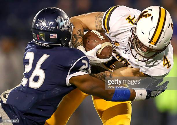 Wyoming Cowboys WR Tanner Gentry is tackled by Nevada CB Kendall Johnson during the game between the Wyoming Cowboys and the Nevada Wolf Pack played...