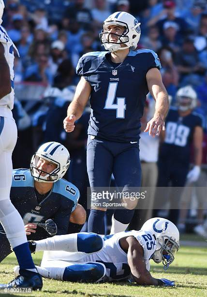 Tennessee Titans place kicker Ryan Succop watches after kicking a field goal as Indianapolis Colts cornerback Patrick Robinson attempted to block it...