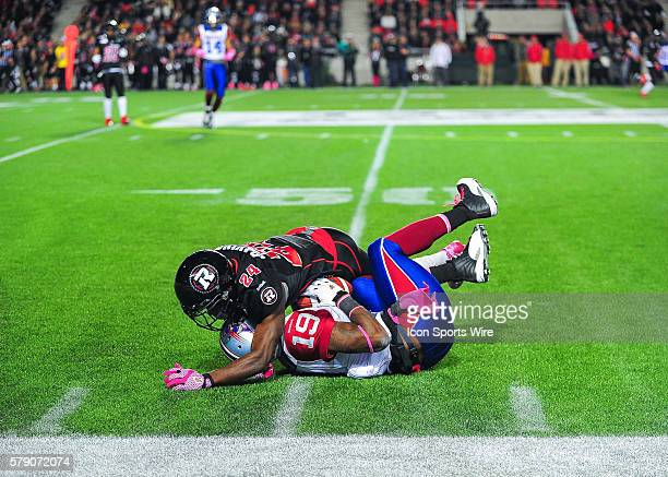 SJ Green is tackled by Jerrell Gavins during the Ottawa RedBlacks game versus the Montreal Alouettes at TD Place Stadium in Ottawa ON Canada The...