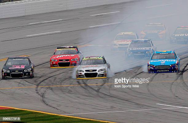 Dale Earnhardt Jr locks up his brakes coming on to pit road during the CampingWorldcom 500 NASCAR Sprint Cup race at the Talladega Superspeedway in...