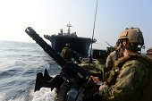 October 26, 2012 - Sailors conduct patrol operations using a riverine command boat.