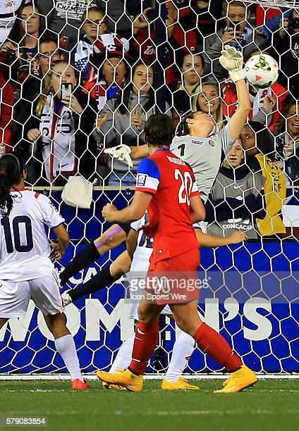 Abby Wambach of the USA heads the ball past Dinnia Diaz of Costa Rica to score during the championship match of the CONCACAF Women's World Cup...