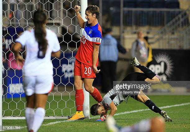 Abby Wambach of the USA stands in from of Dinnia Diaz of Costa Rica and watches the shot by Sydney Leroux score the sixth USA goal during the...