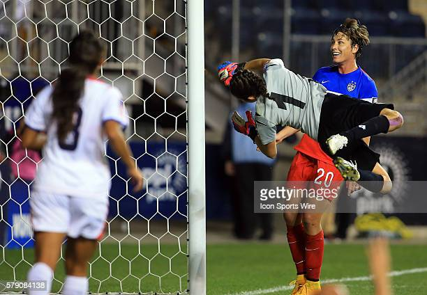 Abby Wambach of the USA watches Sydney Leroux shot beat Dinnia Diaz of Costa Rica for the sixth goal during the championship match of the CONCACAF...