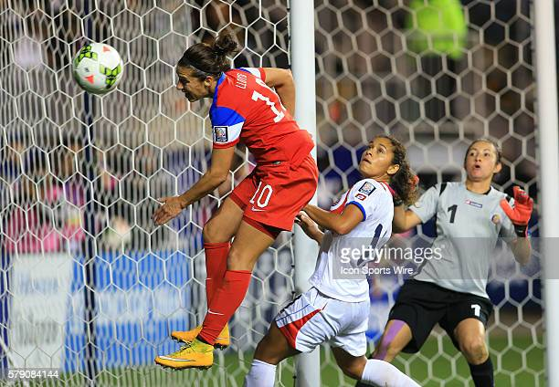Carli Lloyd of the USA heads wide in front of Daniela Cruz and Dinnia Diaz of Costa Rica during the championship match of the CONCACAF Women's World...