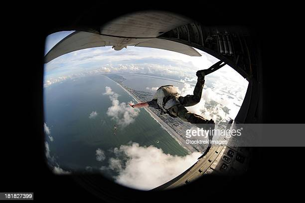 October 27, 2010 - A pararescuemen jumps from an HC-130P/N King while performing a freefall rescue demonstration at Cocoa Beach, Florida.