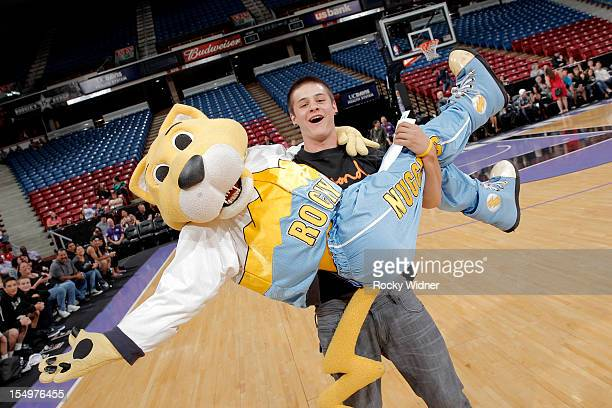 A fan of the Sacramento Kings has fun with Rocky mascot of the Denver Nuggets during Open Practice of the Sacramento Kings on October 28 2012 at...