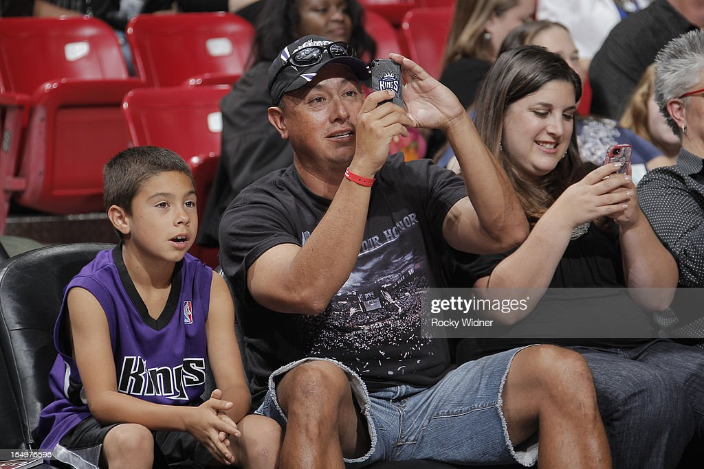 Fans of the Sacramento Kings take photos during Open Practice on October 28, 2012 at Sleep Train Arena in Sacramento, California.