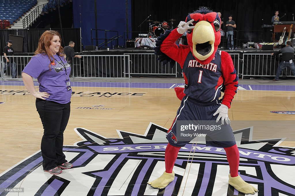 Harry the Hawk dances for a fan of the Sacramento Kings during Open Practice on October 28, 2012 at Sleep Train Arena in Sacramento, California.