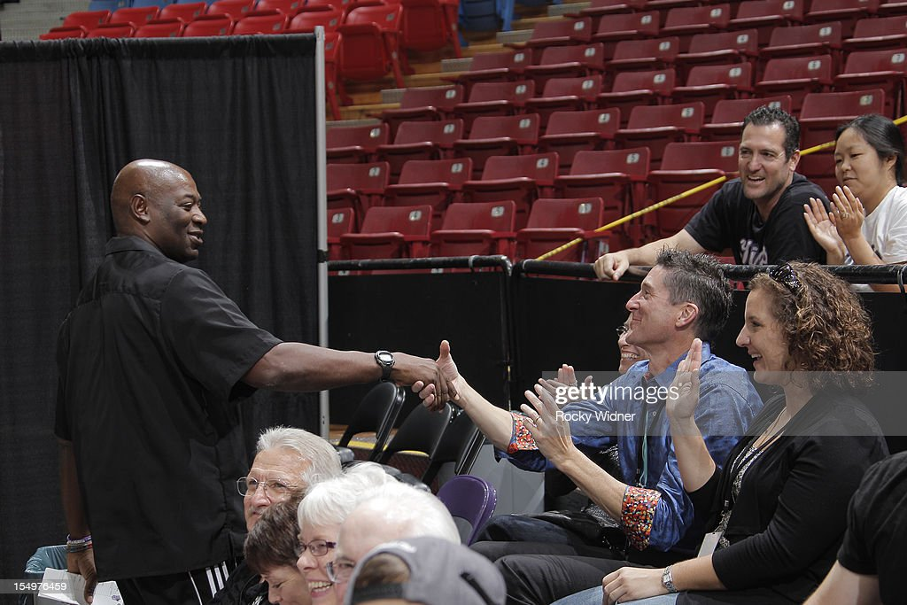 Head Coach Keith Smart of the Sacramento Kings shakes hands with the fans during Open Practice on October 28, 2012 at Sleep Train Arena in Sacramento, California.